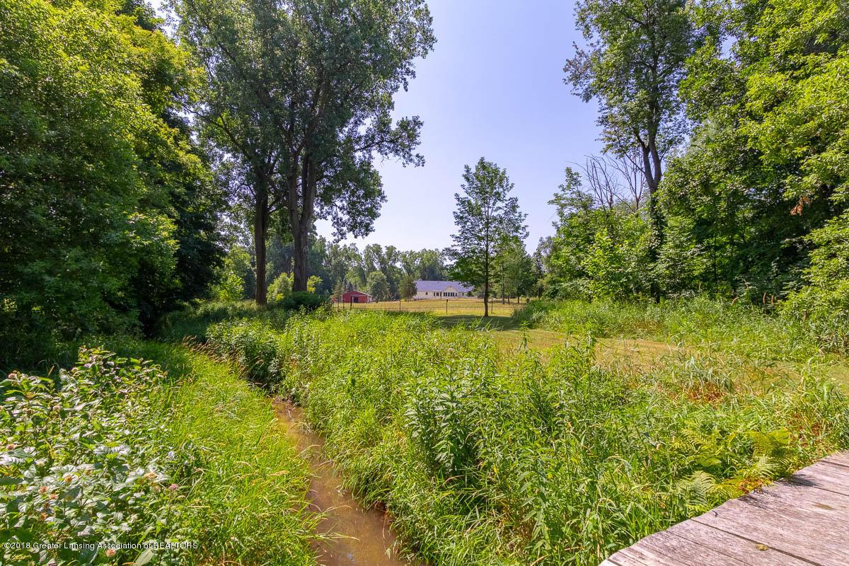 7511 Herbison Rd - Creek with charming bridge - 41