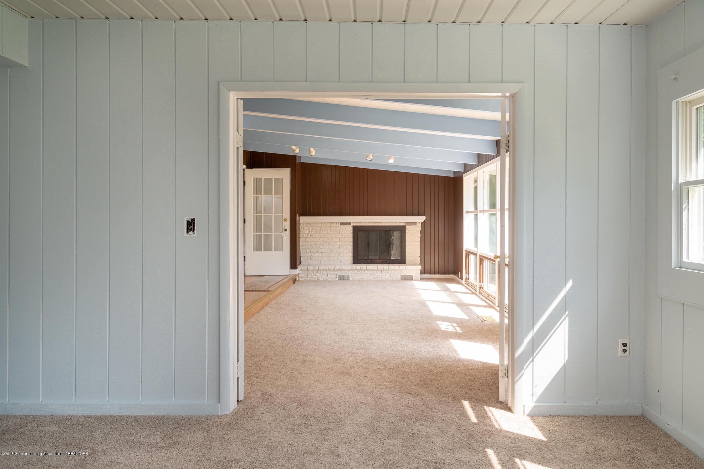 1211 Daisy Ln - view into great room from bonus room - 17