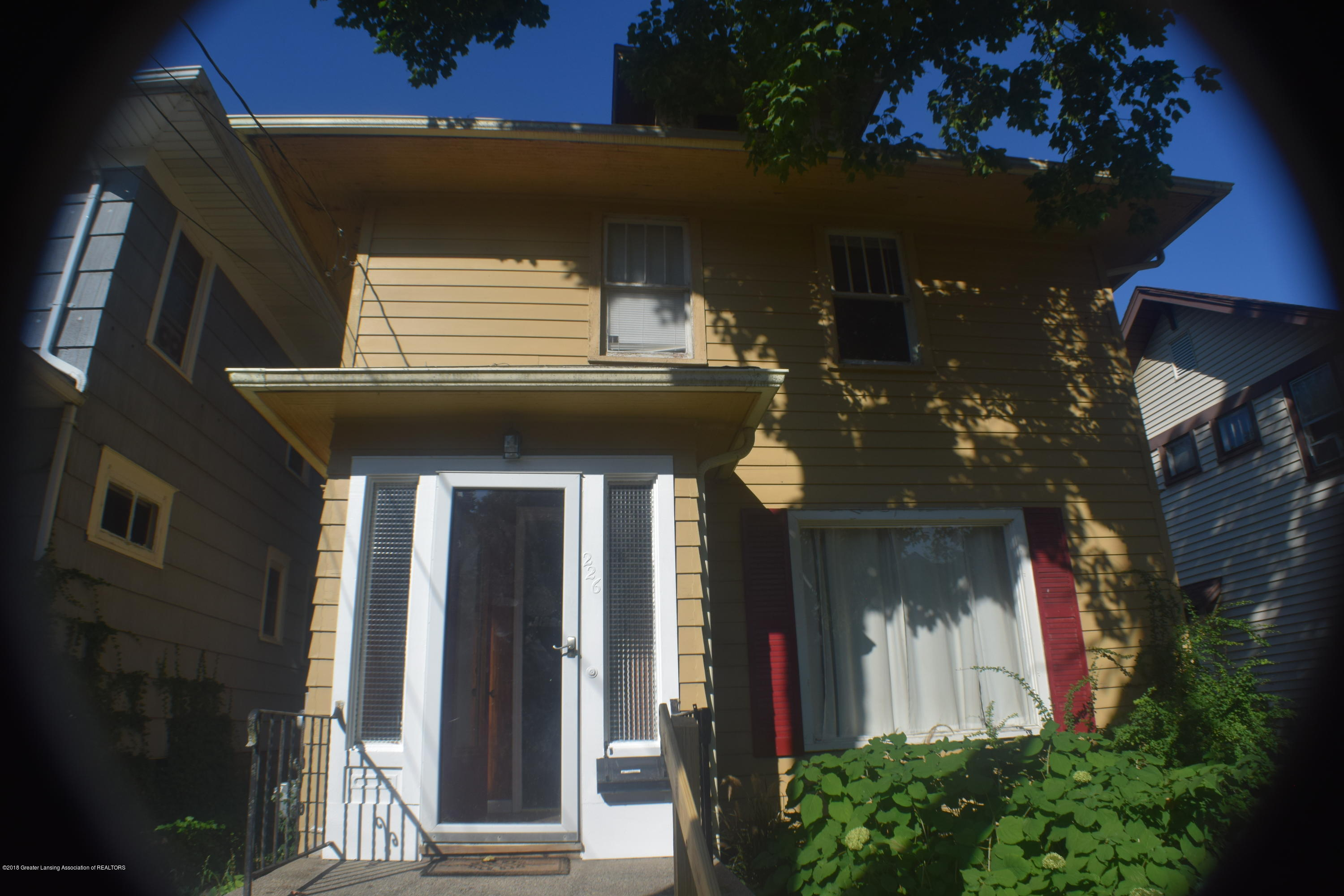 226 Leslie St - House Street View - 1