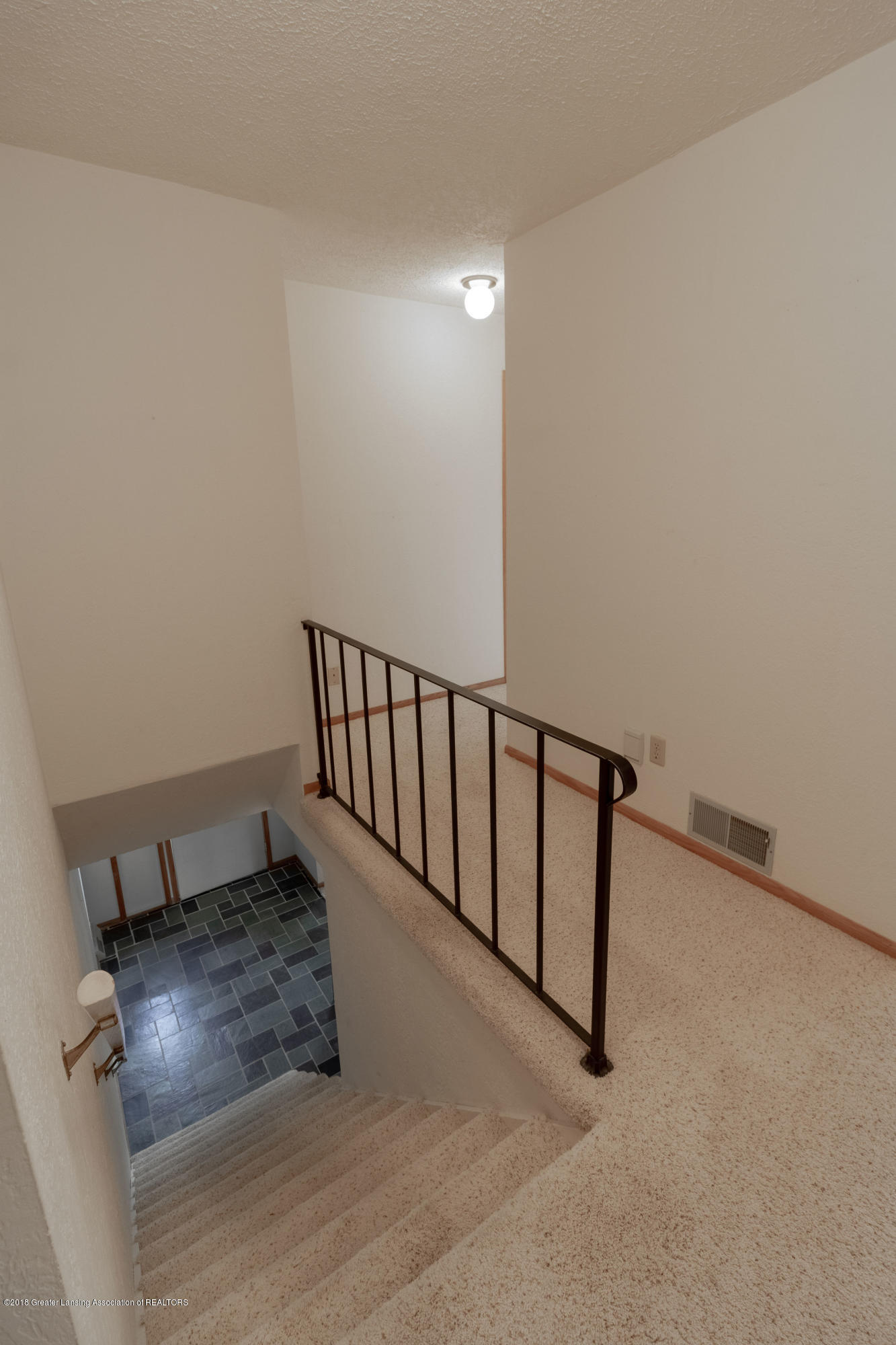 8057 Hunter Rd - Stairs to Main Level - 27
