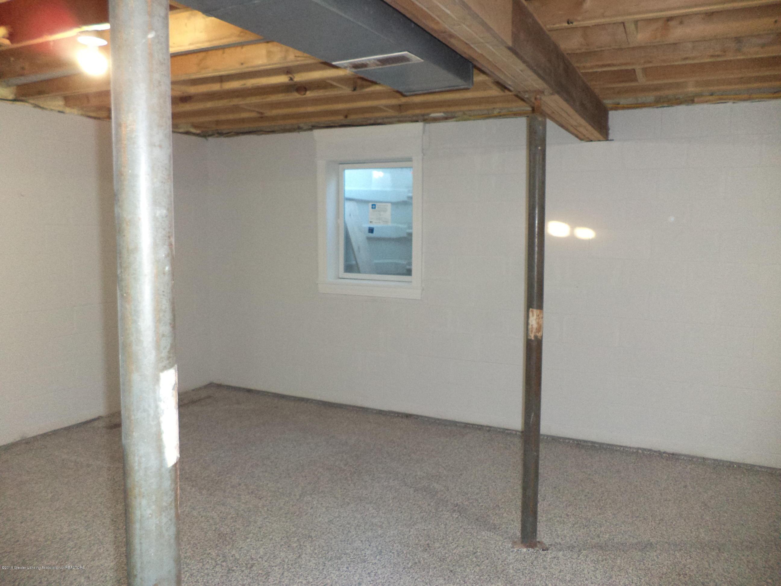 3200 S Dewitt Rd - Lower level 3 egress window - 30