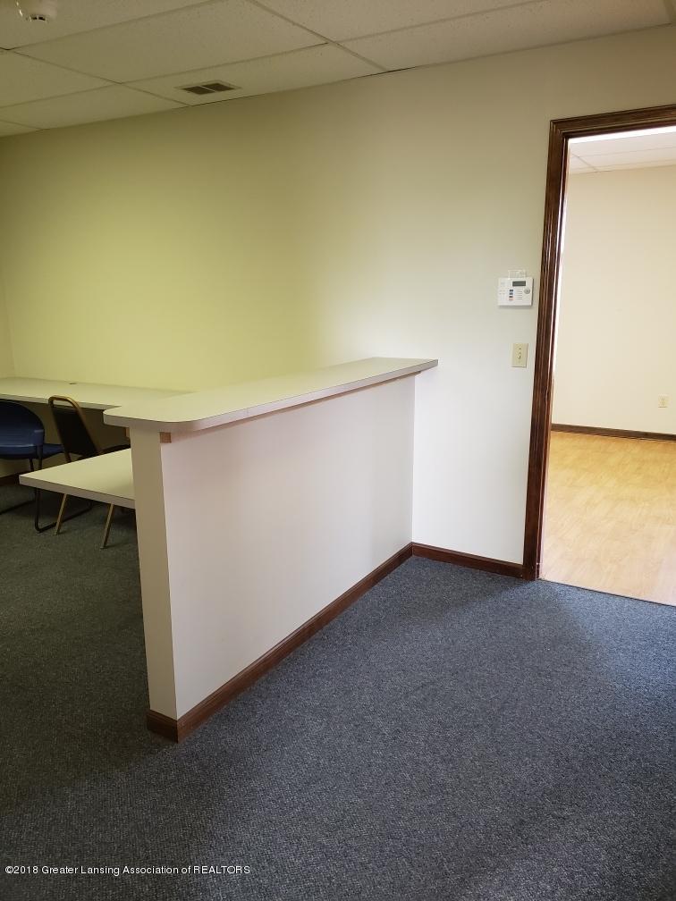2487 S Michigan Rd Unit E - Reception Area with built-in desk - 11