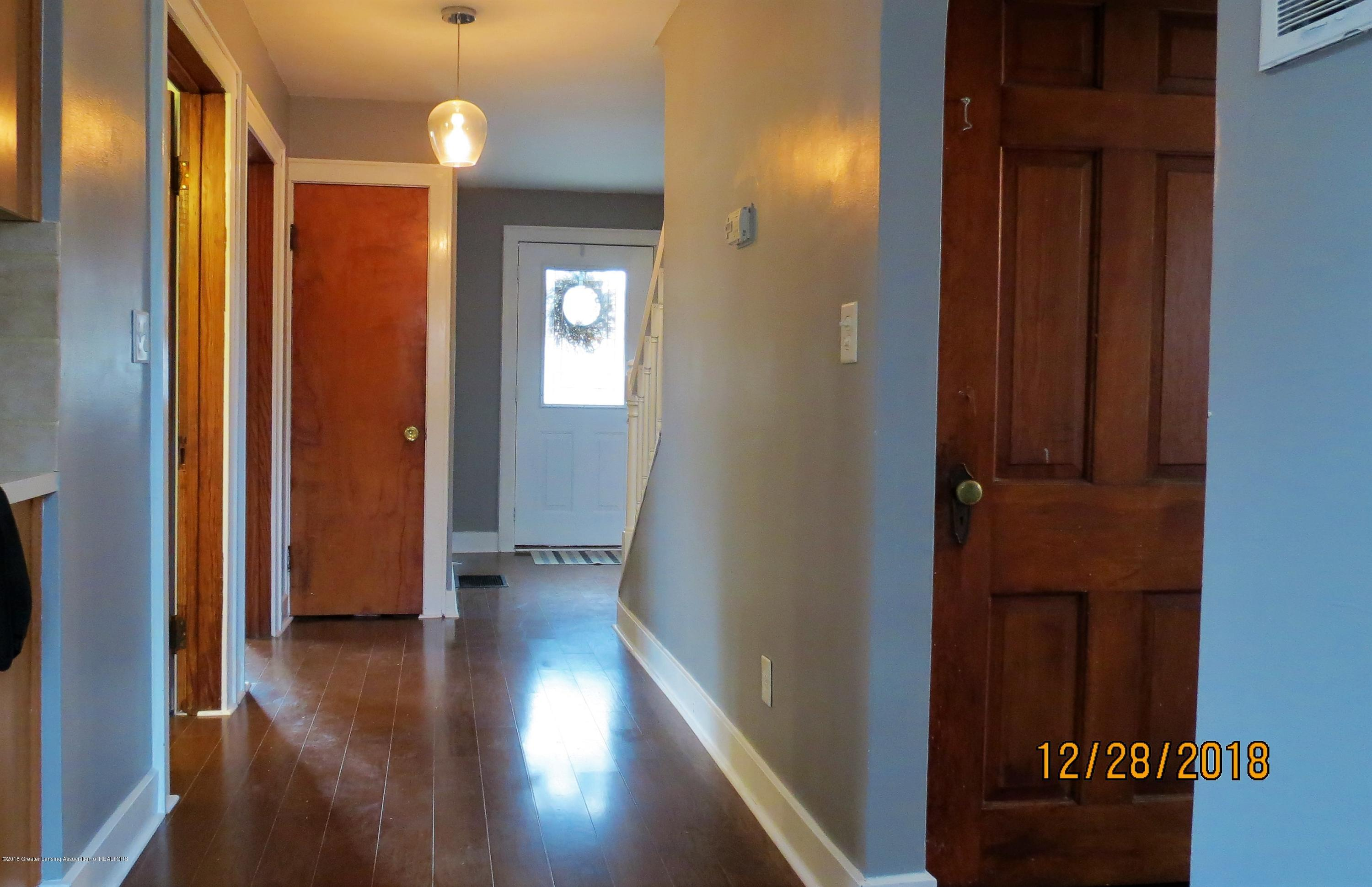 520 Pleasant St - Front entry way and basement door - 19