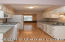 Galley Style kitchen offers plenty of countertop and cabinet space