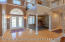 Great view of archway and pillars bordering the Formal Dining Room.