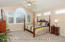 Cathedral ceilings, newer carpeting, ceiling fan and many windows