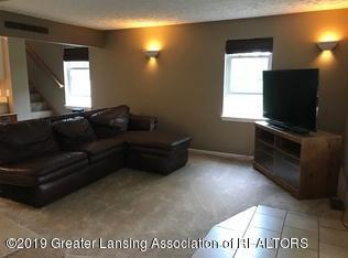 8183 Colby Lake Rd - LR with couch no walls - 5
