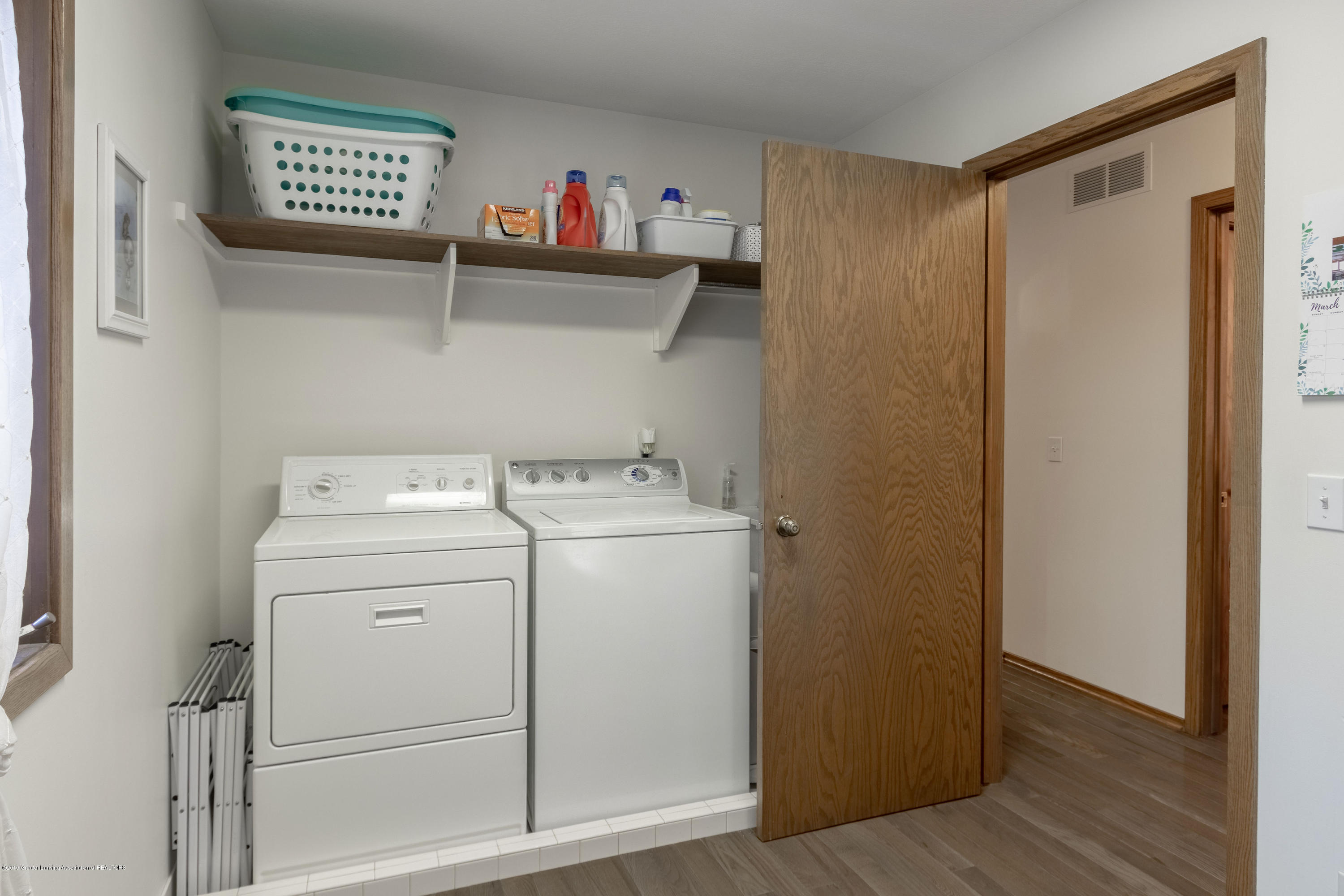 2543 Dustin Rd - Large separated laundry room on the 1st - 17
