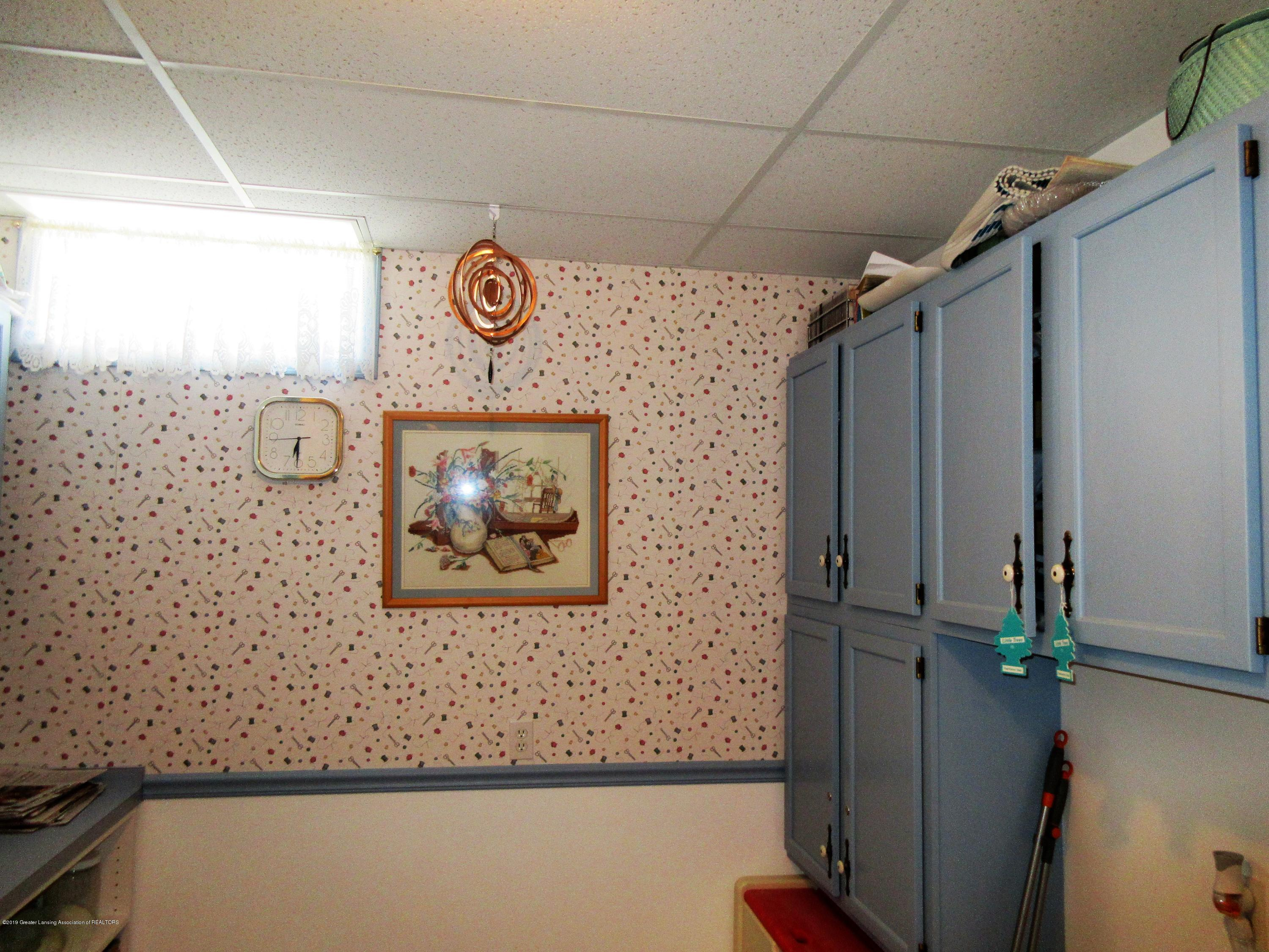 9387 S Hollister Rd - craft room - 21