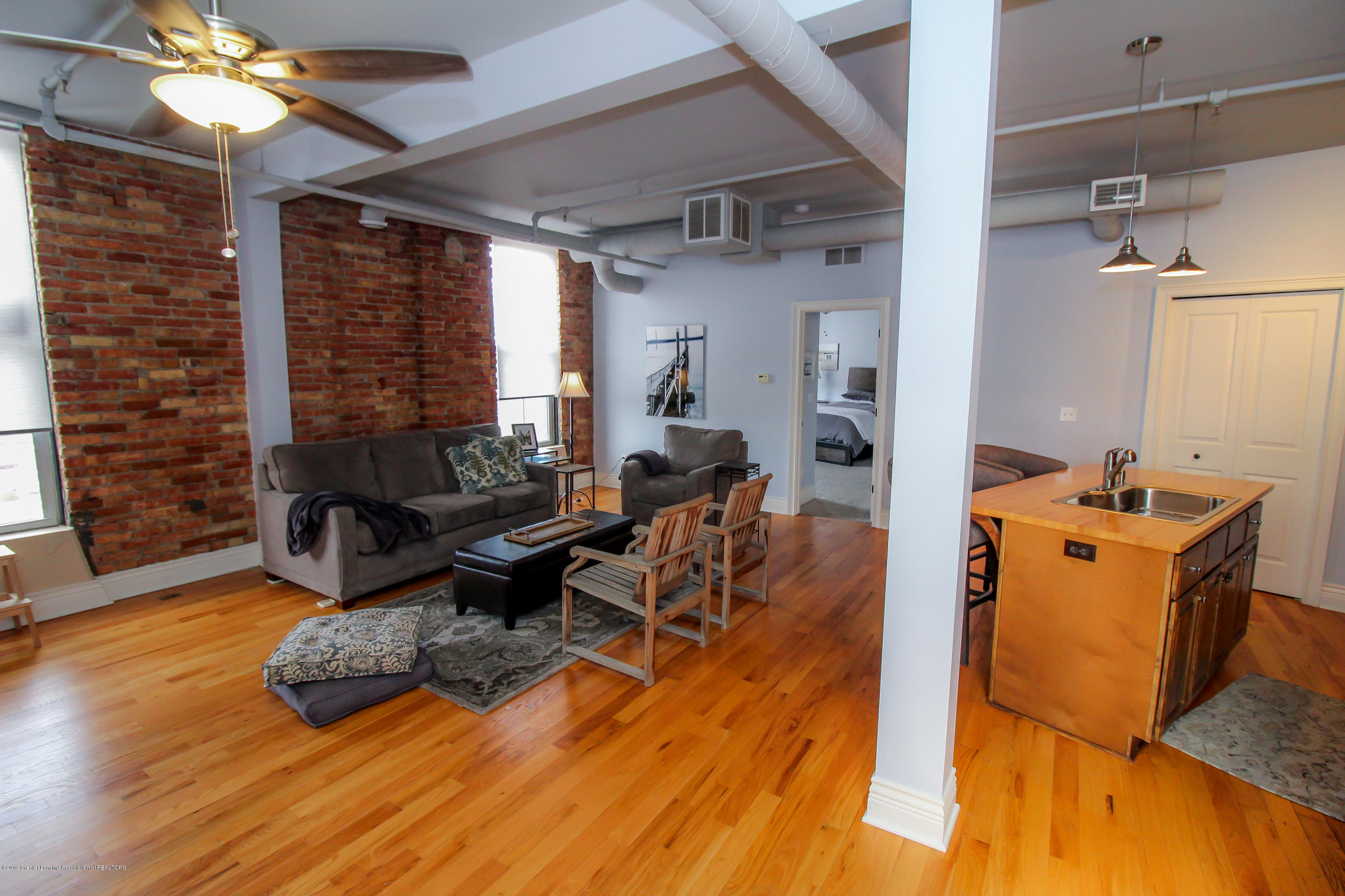 109 E Grand River Ave 4 - open concept living space - 4