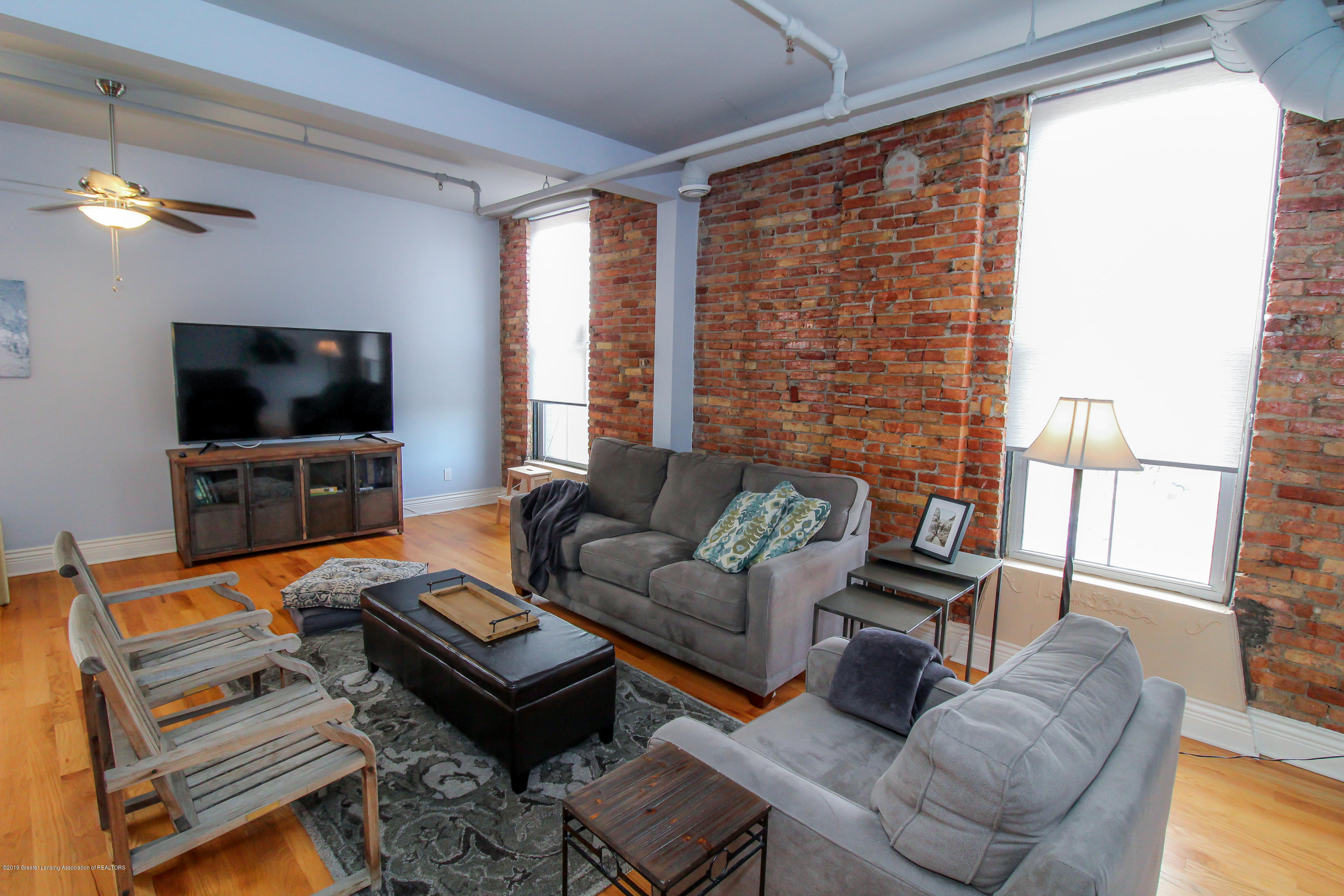 109 E Grand River Ave 4 - exposed brick..open living space - 7