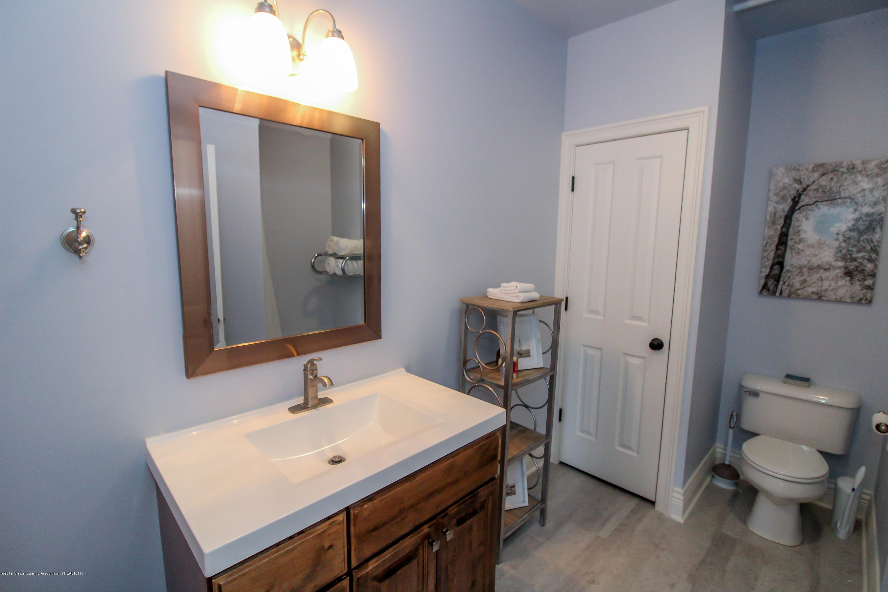 109 E Grand River Ave 4 - master bath - 16