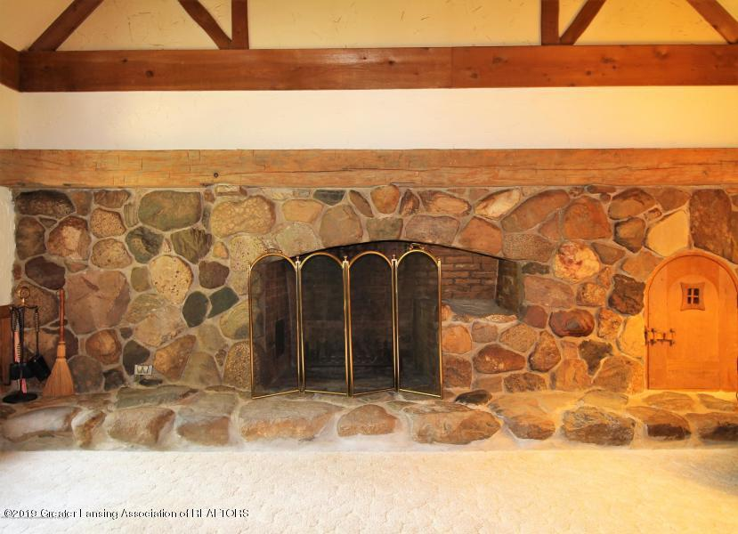 12895 Eaton Rapids Rd - Fireplace with wood storage hatch - 20