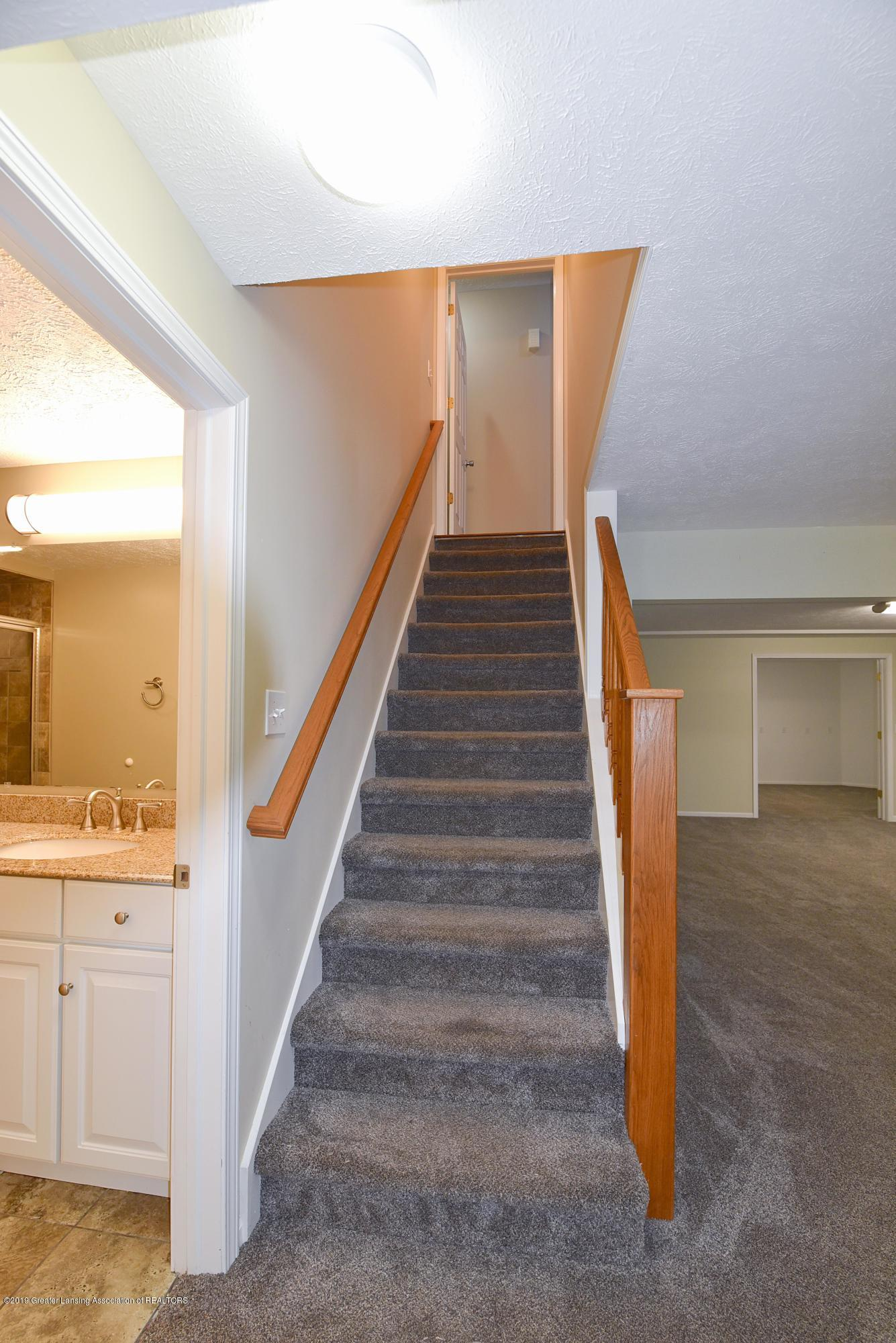 3300 Hollow Spring Dr - Stairs from lower level - 32
