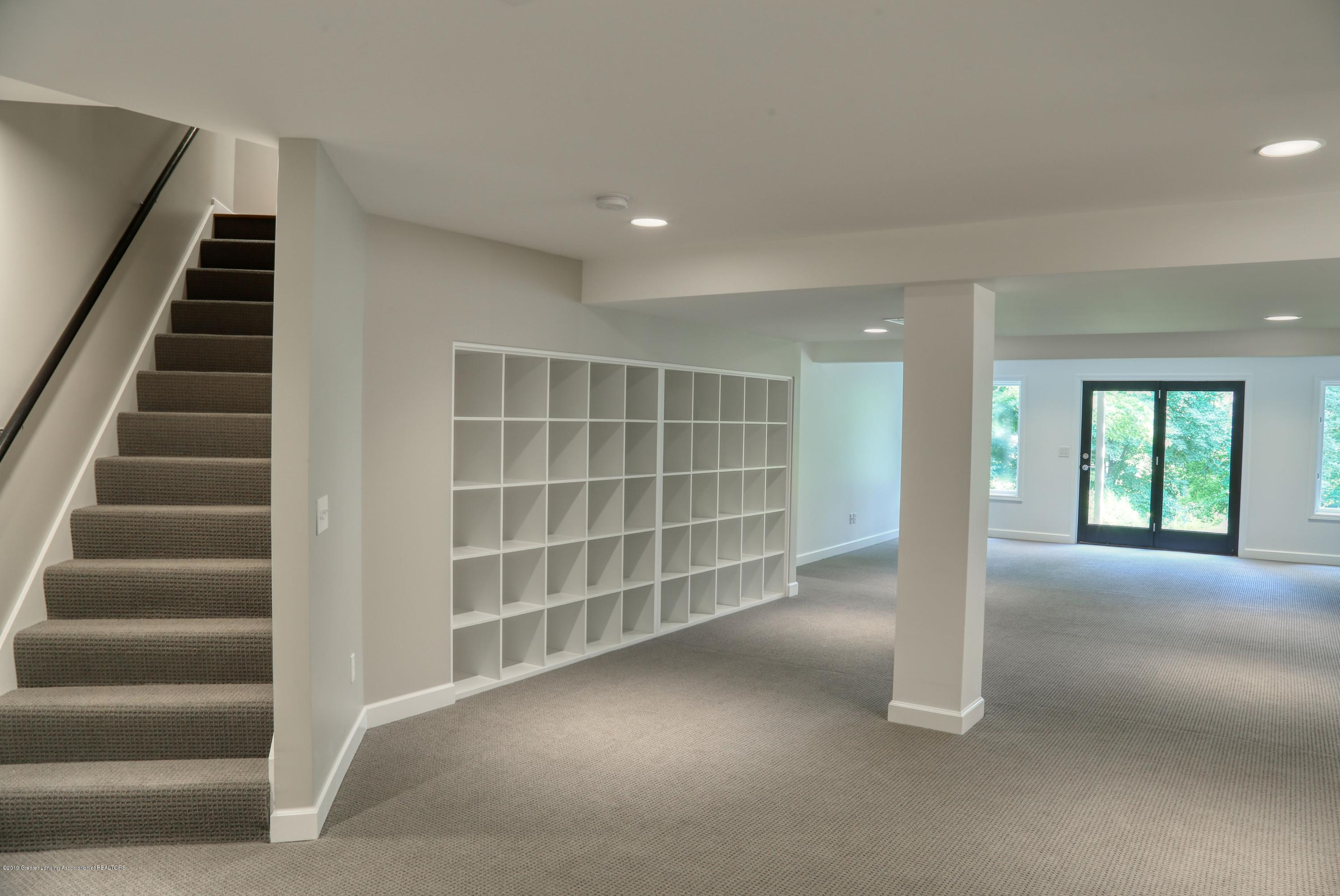 Lower Level Stairs and Built in Shelving