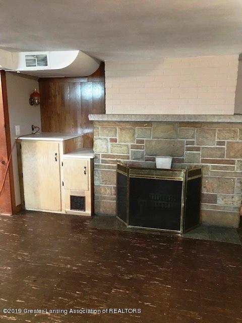 4632 Old Lansing Rd - old lansing basement fireplace - 12