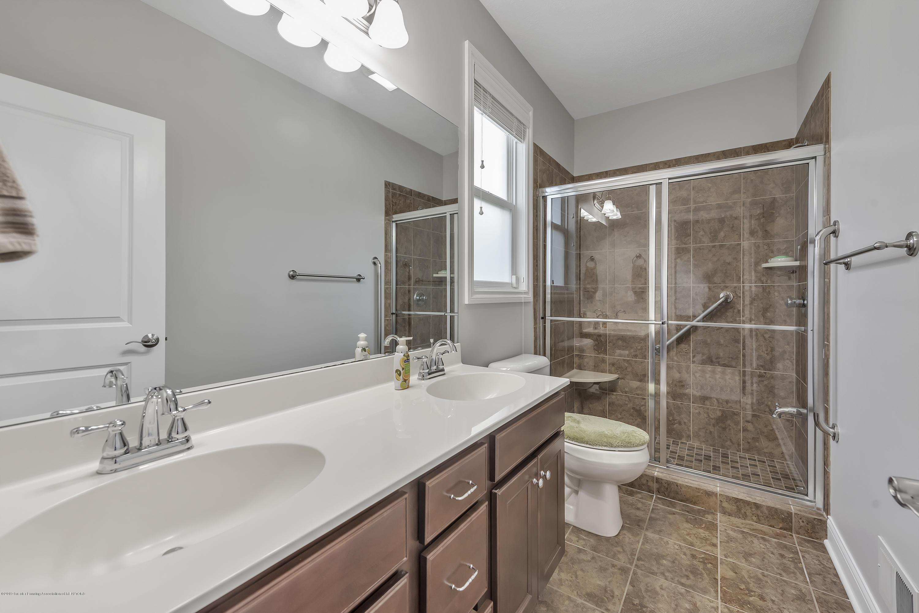 4229 Rain Forest Cir - 4229-Rainforest-Circle-Okemos-MI-windows - 25
