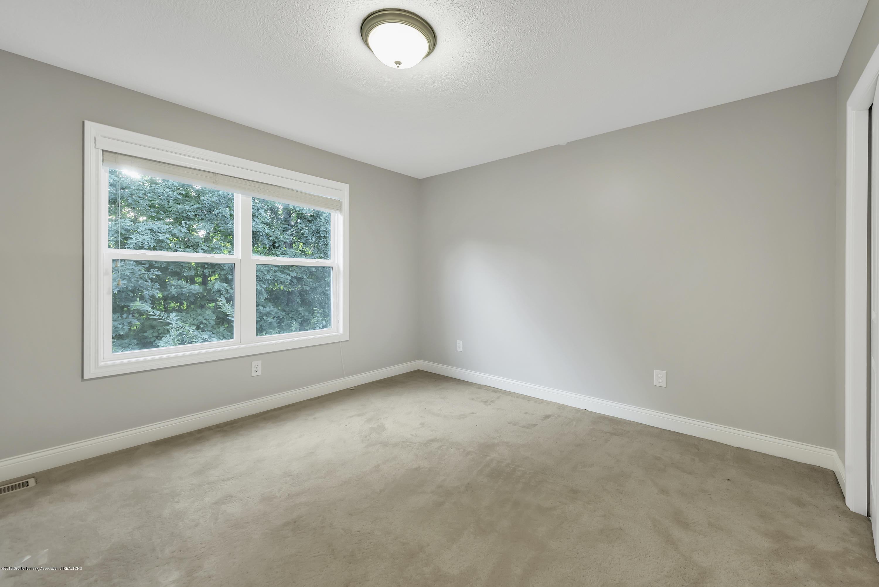 4229 Rain Forest Cir - 4229-Rainforest-Circle-Okemos-MI-windows - 39