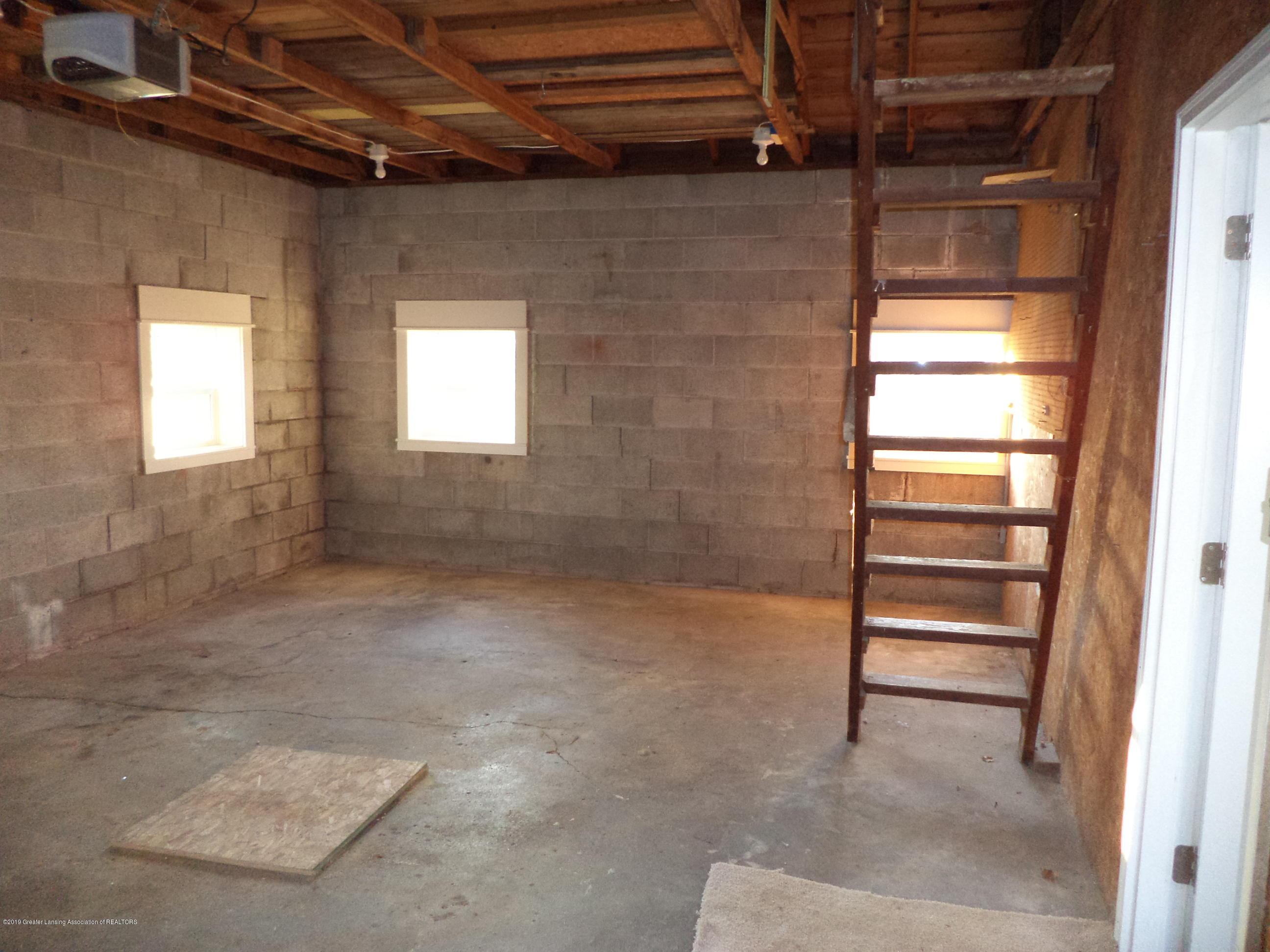 3200 S Dewitt Rd - Garage interior view 2 & stairs up - 34