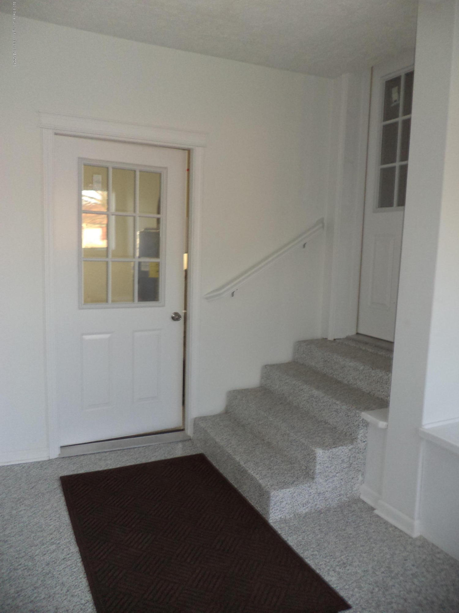 3200 S Dewitt Rd - Foyer area to laundry and inside house - 24