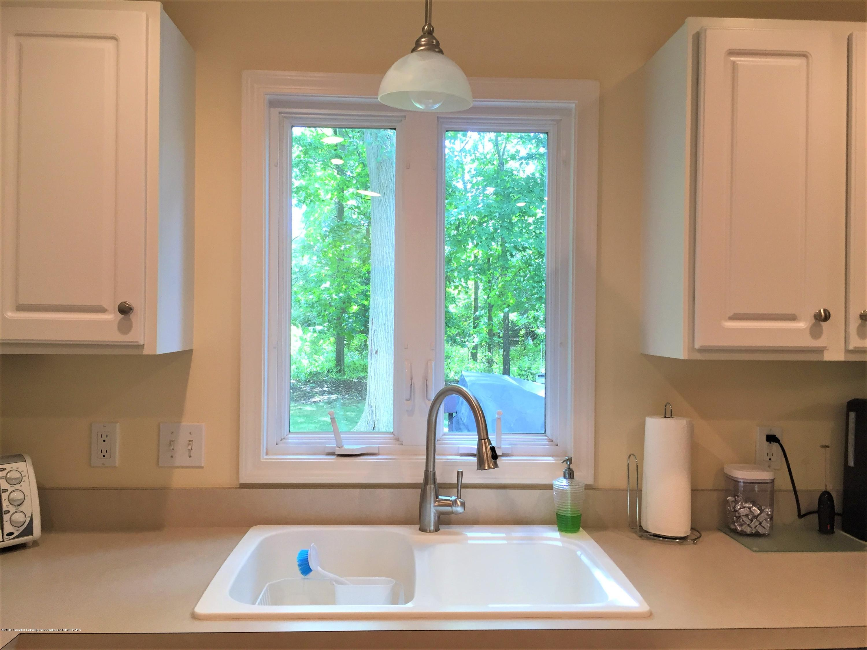 8617 Wheatdale Dr - Kitchen Sink/View of Wooded Lot - 9