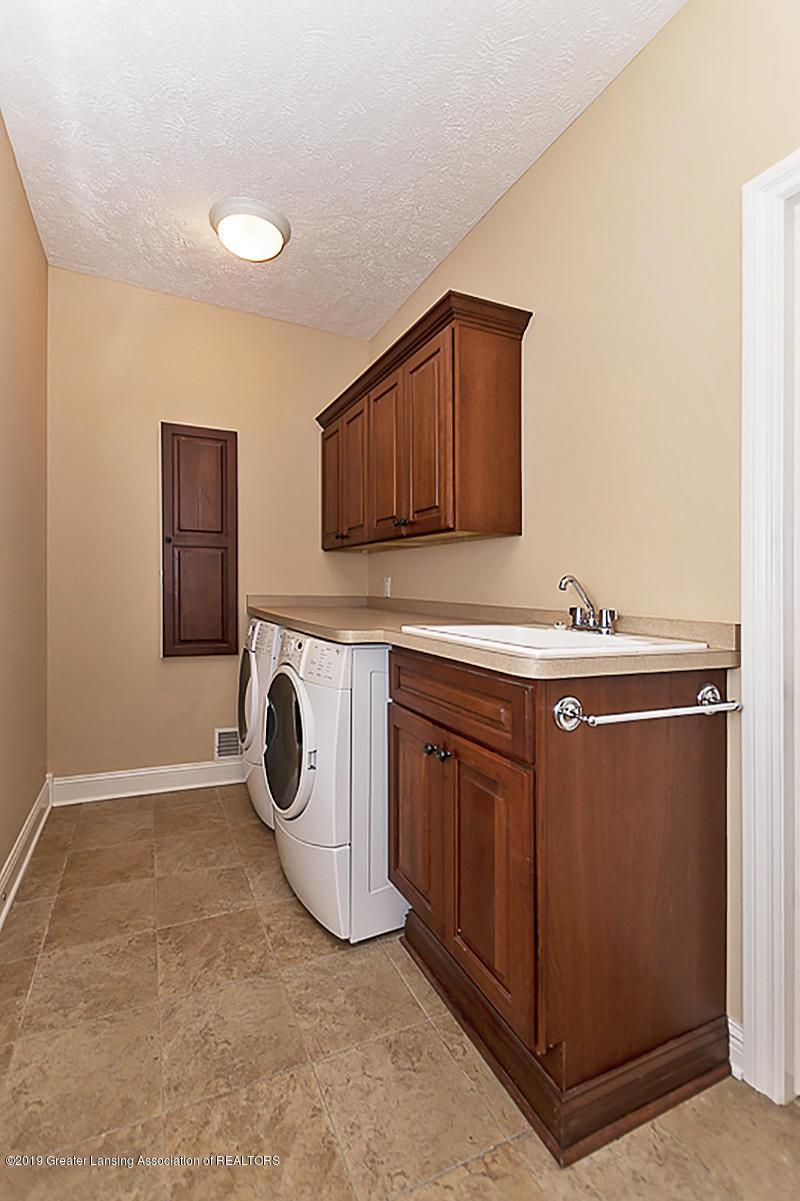 6149 Bridgewater Cir 49 - 6149 Bridgewater 1st fl laundry and back - 2