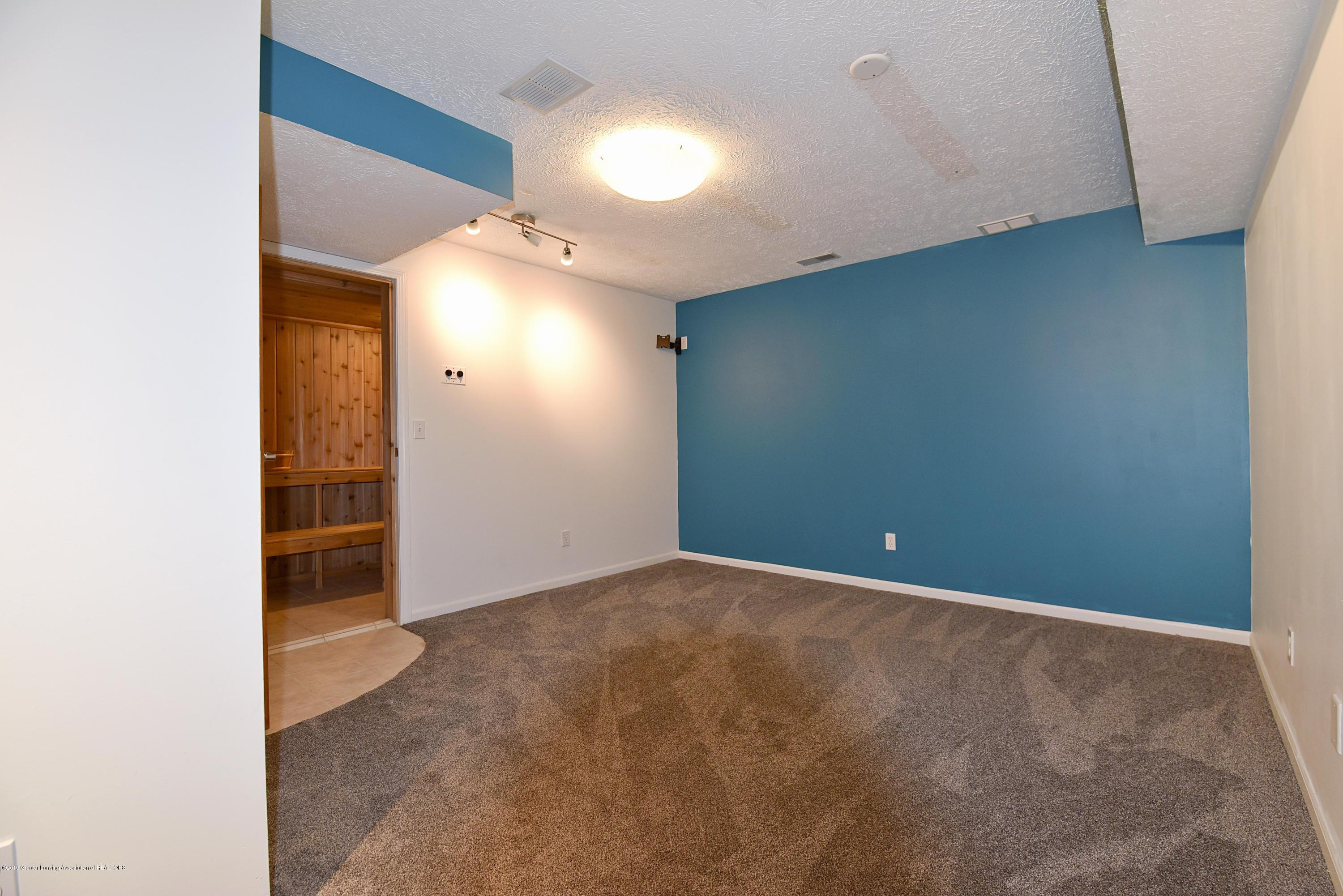 3300 Hollow Spring Dr - Lower level gym with sauna - 34