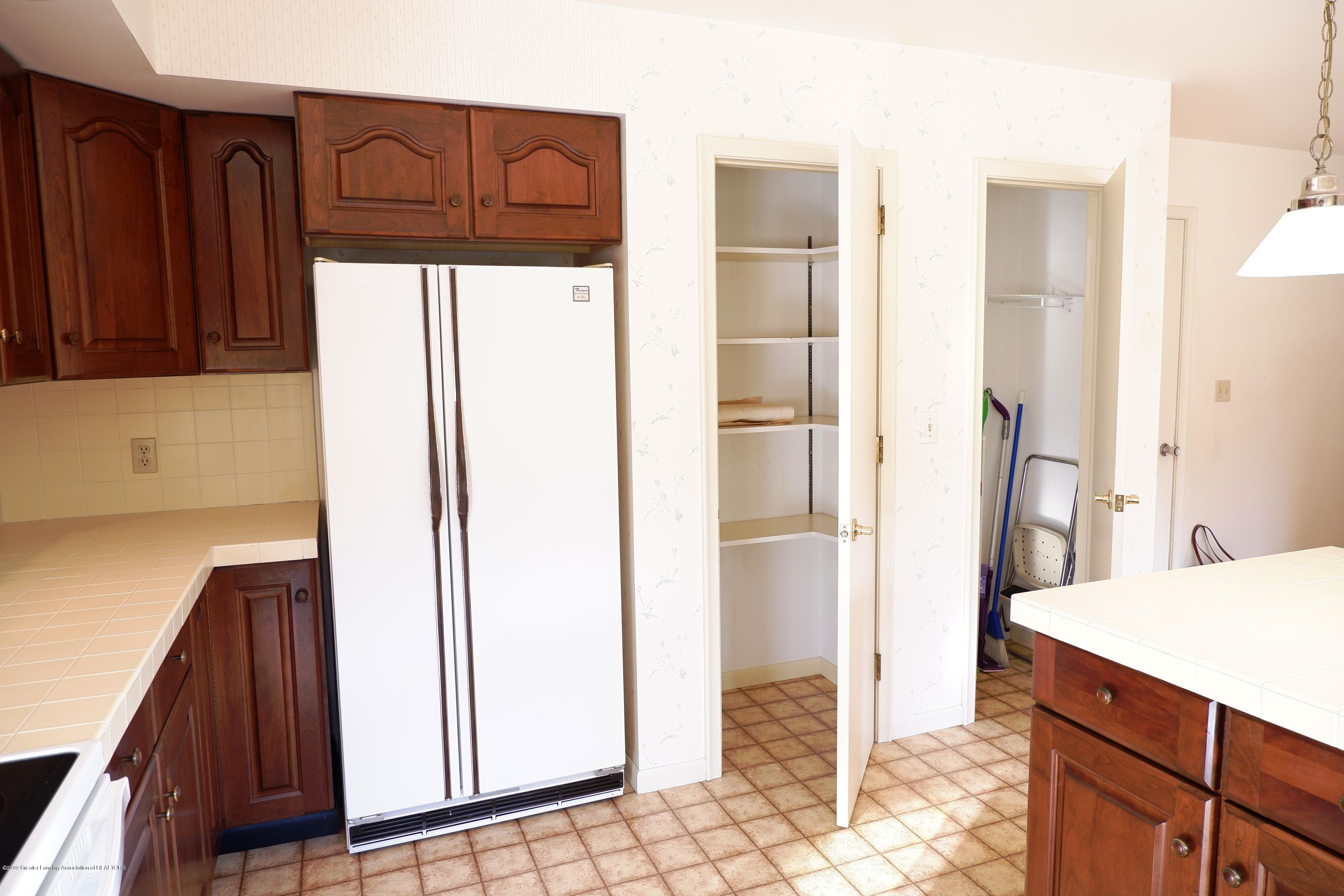 8933 W Scenic Lake Dr - Pantry & cleaning closets - 18