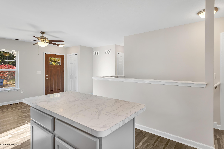 5945 Selfridge Blvd - island/stairwell - 12