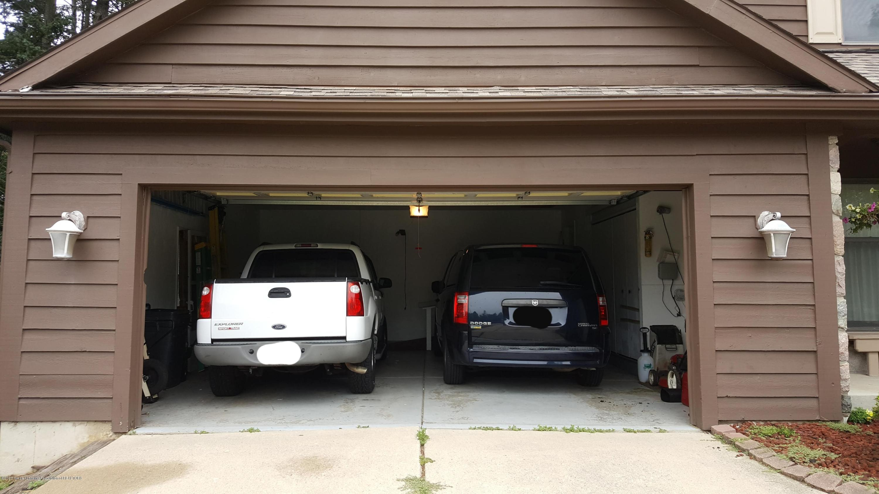 4284 Conifer Cir - Garage open with cars - 41
