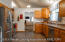 Beautil large open kitchen featuring high ceilings!