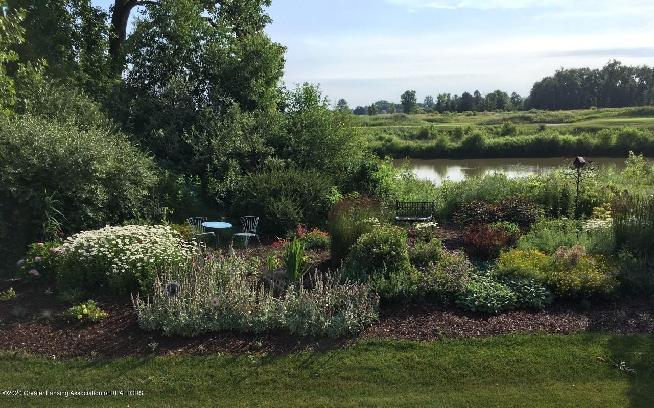528 Aquila Dr - Summer View of Garden & Pond - 60