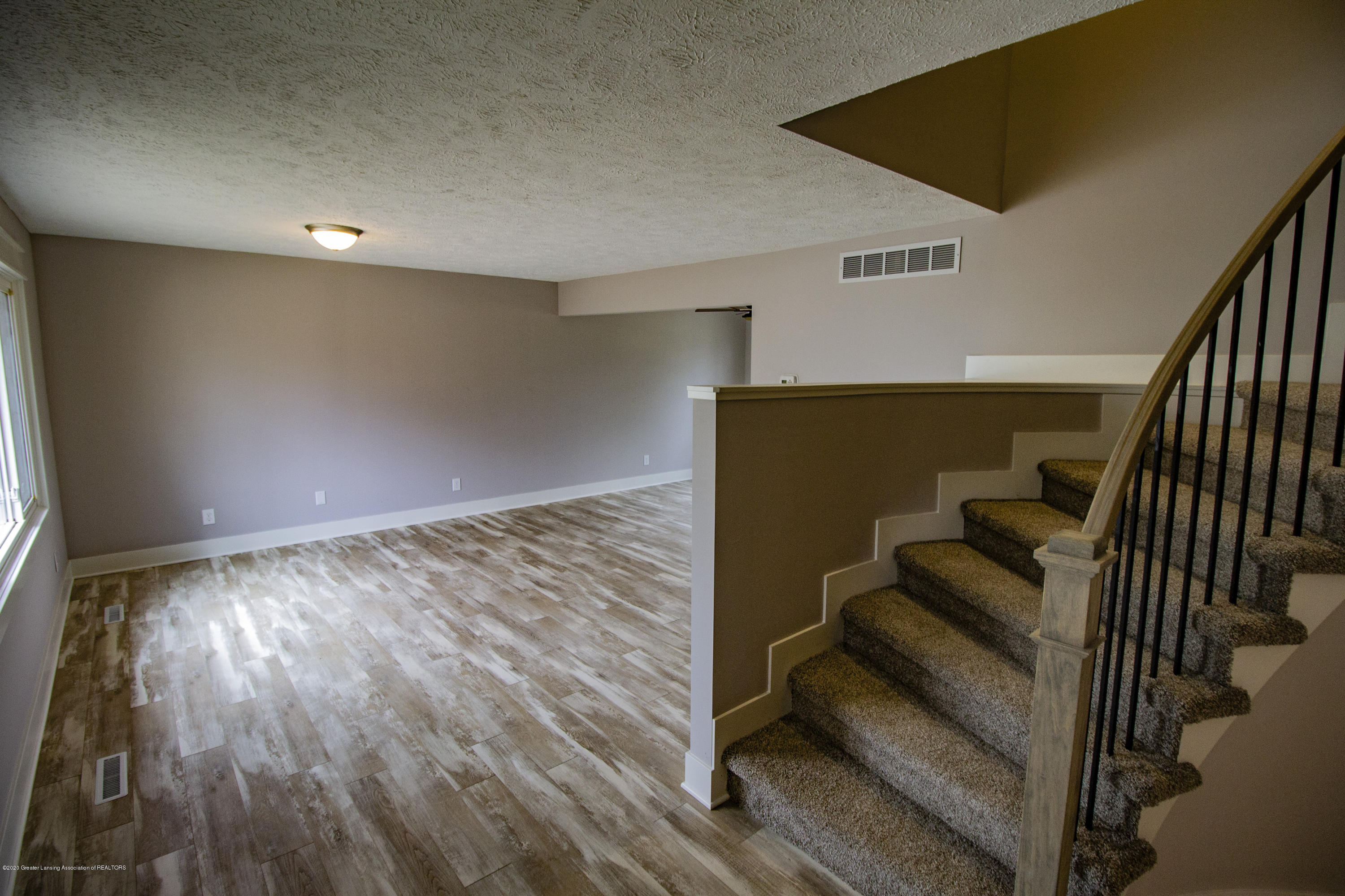5407 Catalpa Dr - Living room and stairs - 2