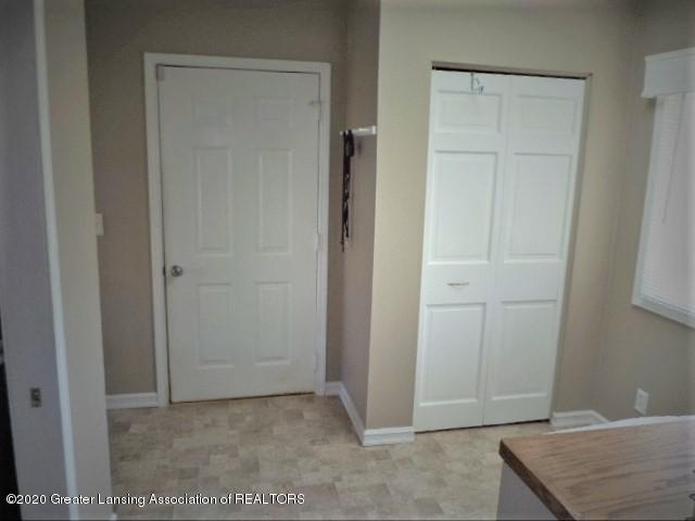 401 Meadowview Dr - Utility Room storage & garage entry door - 34