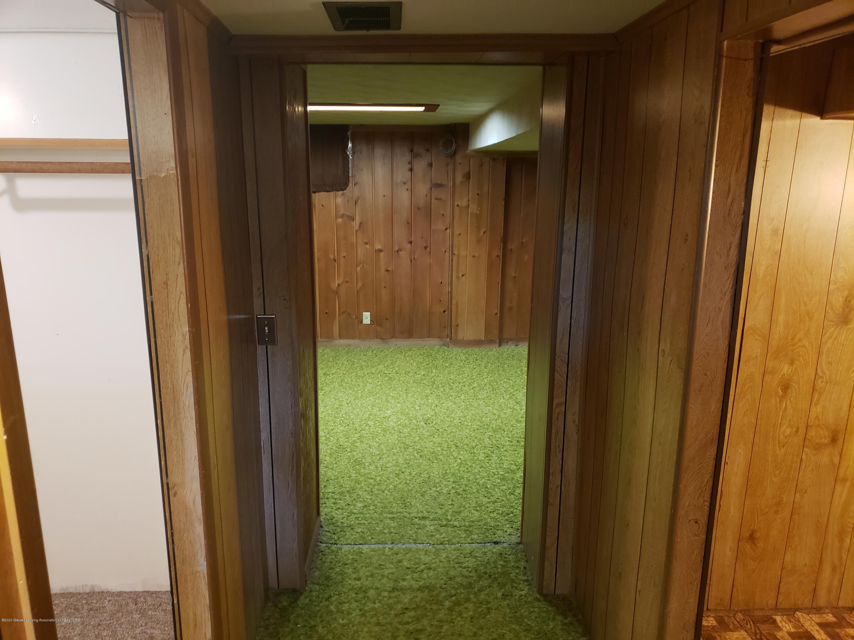 313 E Shepherd St - basement hallway from bottom of stairs - 32