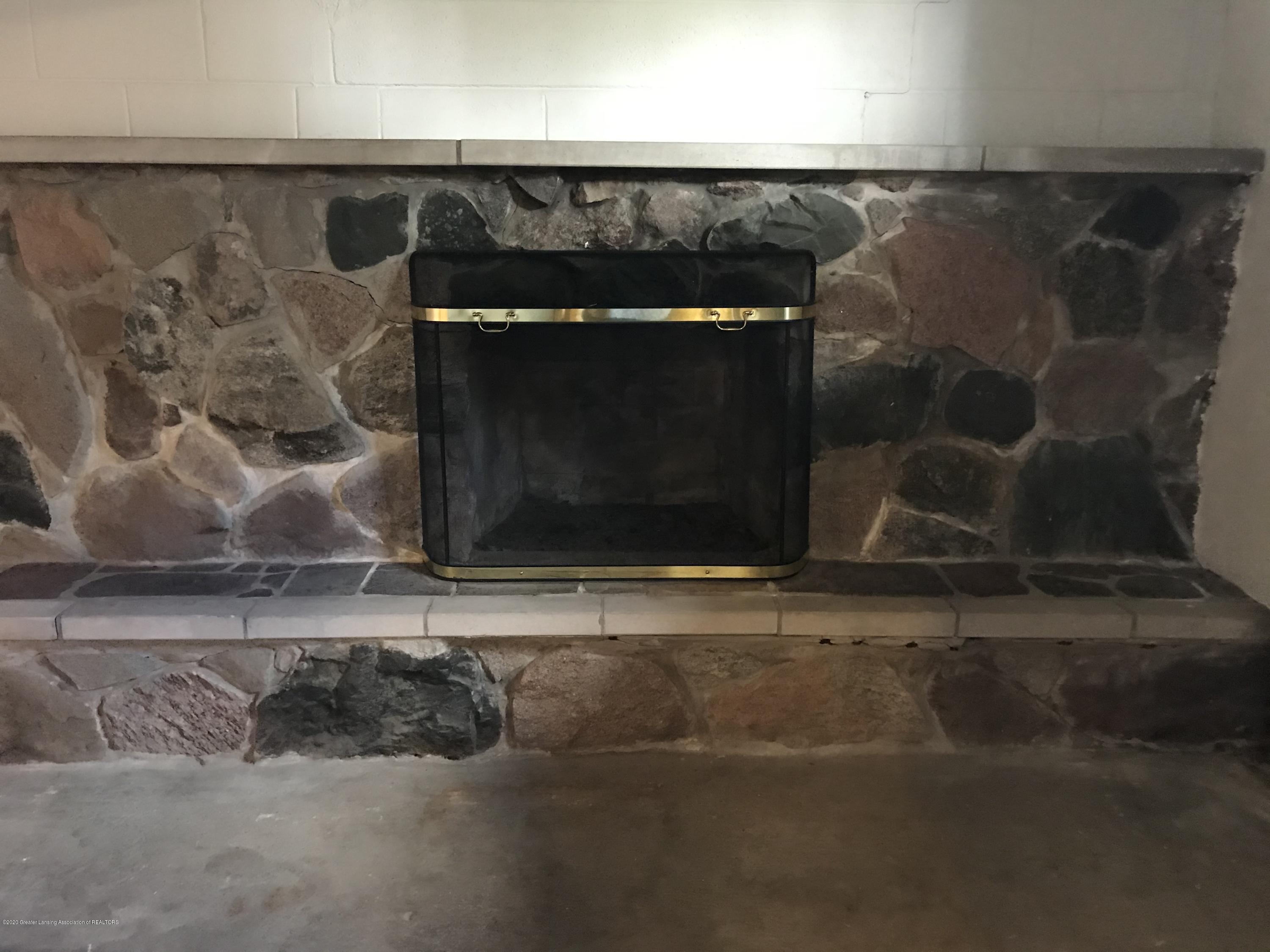 7840 Colby Lake Rd - Lower level fireplace room - 16