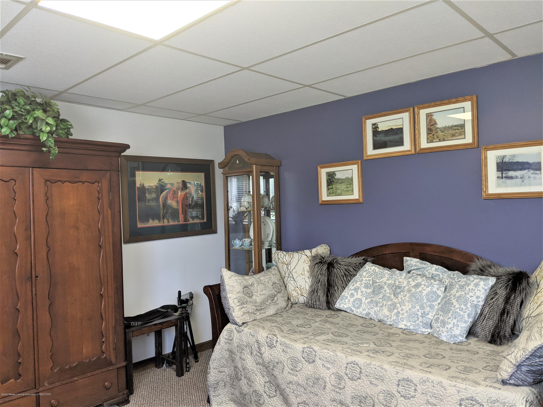 7928 Tyrrell Rd - purple bedroom - 24