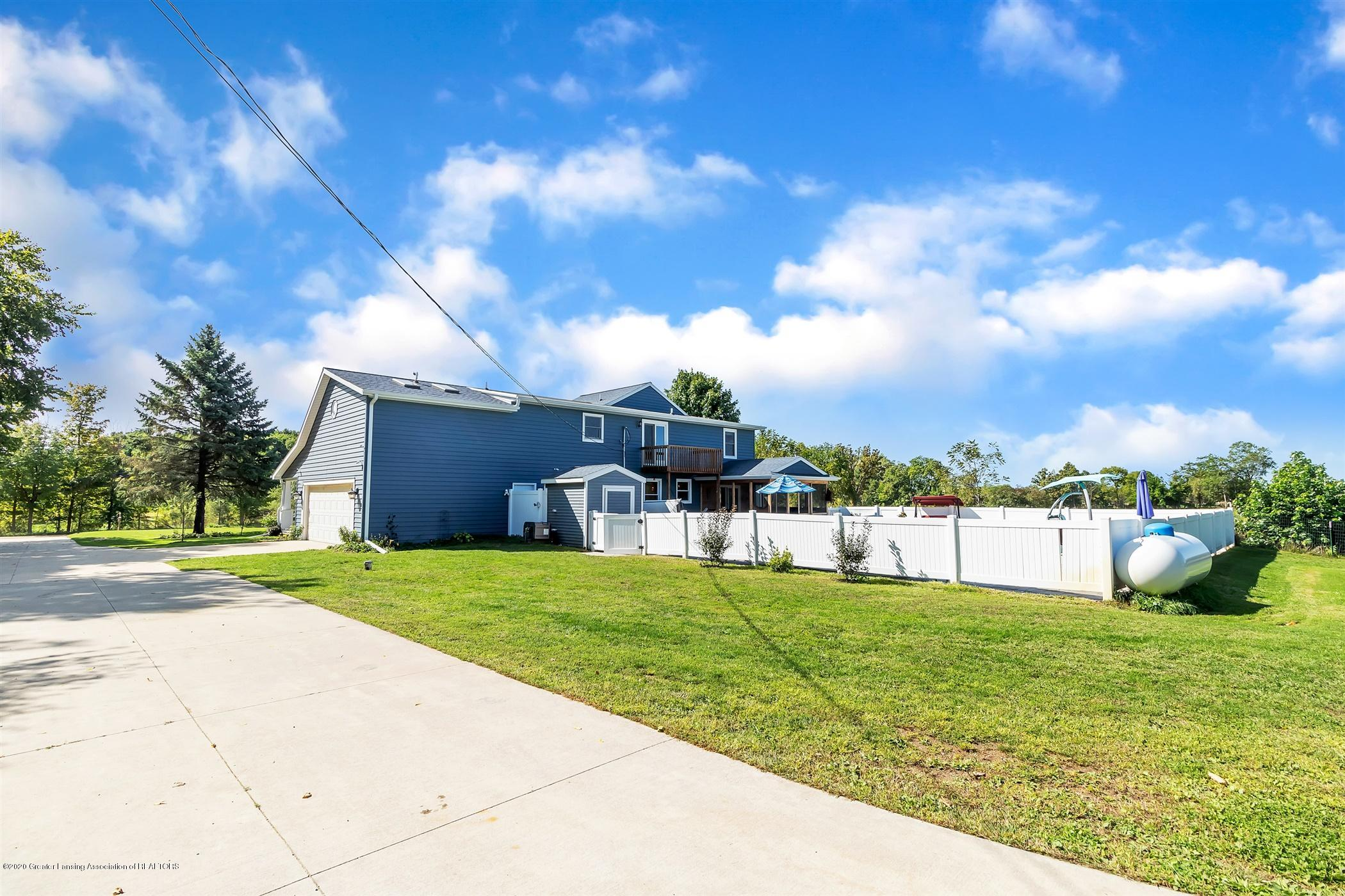 7346 W Cutler Rd - PRIVACY FENCE AROUND POOL, PROPANE TANK - 66