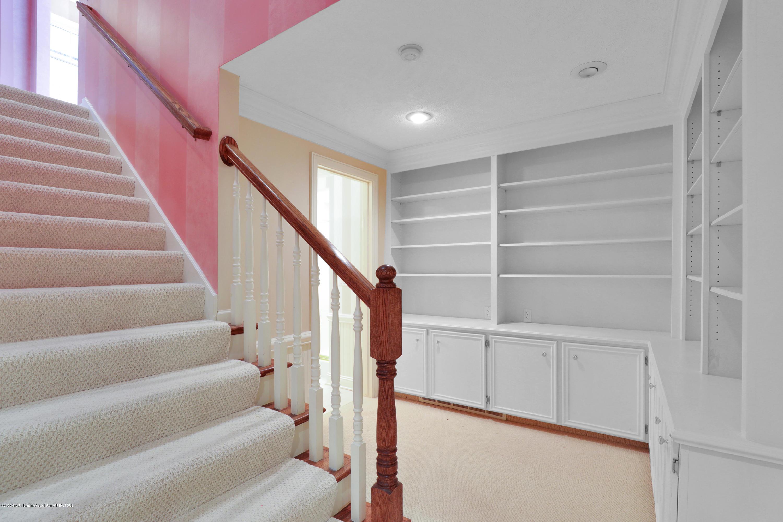 6143 E Longview Dr - lower level built in shelves - 28