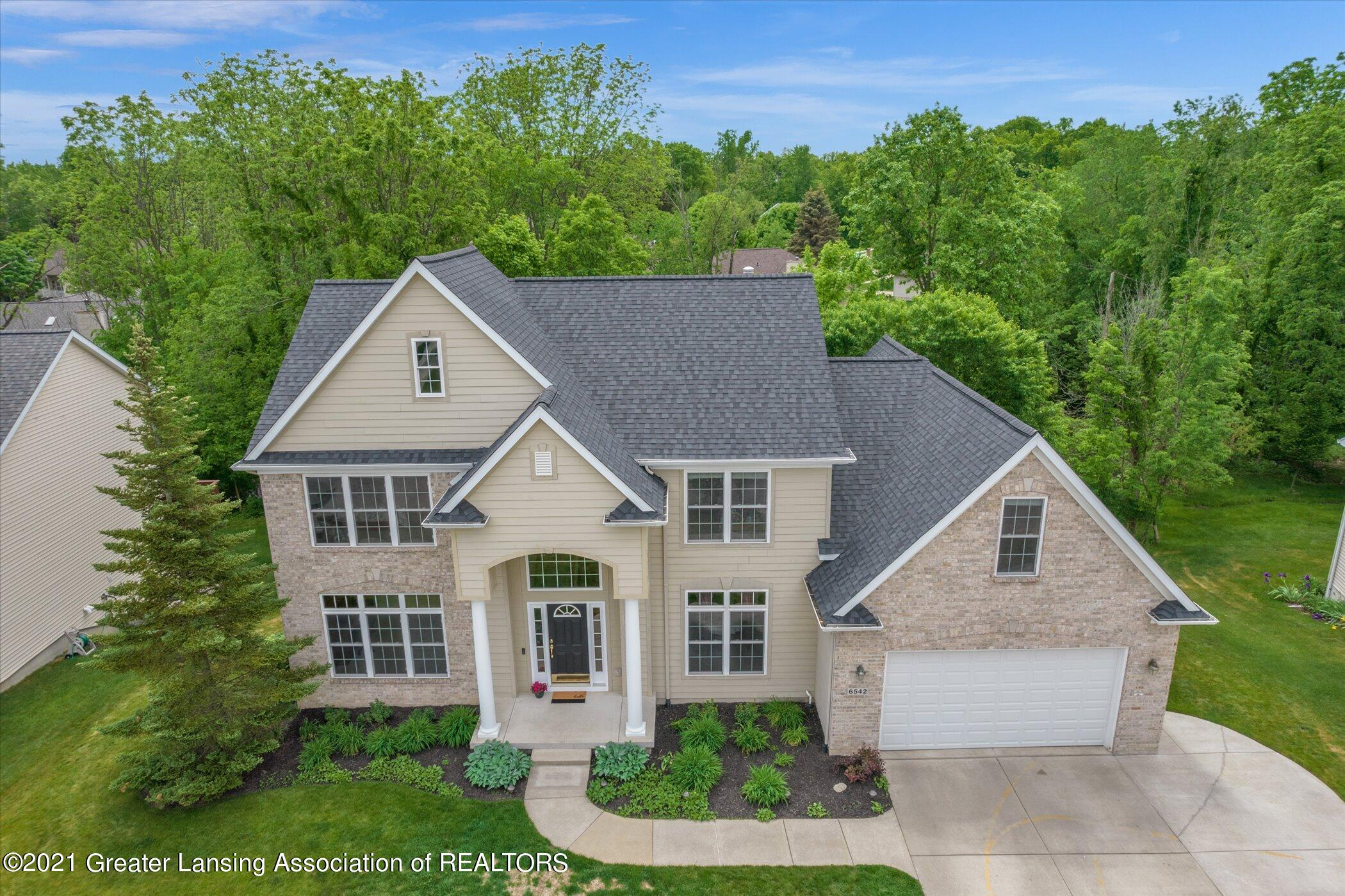 6542 White Clover Dr - EXTERIOR Front View Aerial - 2