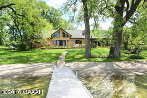 Level, sandy beach, private acreage, mature trees, stables, sheds, large beautiful home plus a guest cottage!