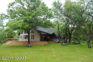 Beautiful home on 50 acres with 6 AC Lak