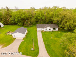 3 bedroom rambler on 5.62 acres - detached and attached garage, plus huge quonset and machine shed.