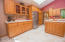 Beautiful kitchen, Light filled by the skylight, Swedberg Cabinets, many pullouts, center island and pantry.