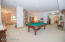 Game & Rec room -- pool table is a must here! Room for kids and guests of all ages! Walk out to lakeside as well!
