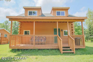 Getaway today! Here is a comfortable log home ready for all the fun! Sleeps 6-8 comfortably! Association offers marina area for lakeside picnics and recreation along with a play area!