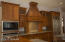 Subzero fridge, Wolf cook top, built in wall oven and microwave