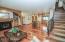 Brazilian hardwood floors. This view features the stairway to Master en-suite.