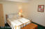 Lower bedroom is naturally light filled and has a walk thru 3/4 bath