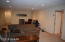 spacious lower level with office space, bedroom and bath